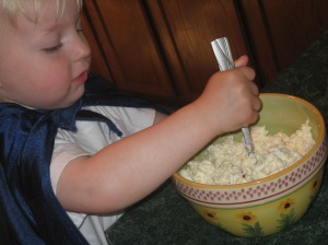 Jamie helping stir.