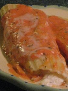 Seafood-stuffed manicotti in creamy marinara sauce.