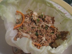 Place spoonfuls of filling into each cabbage leaf.